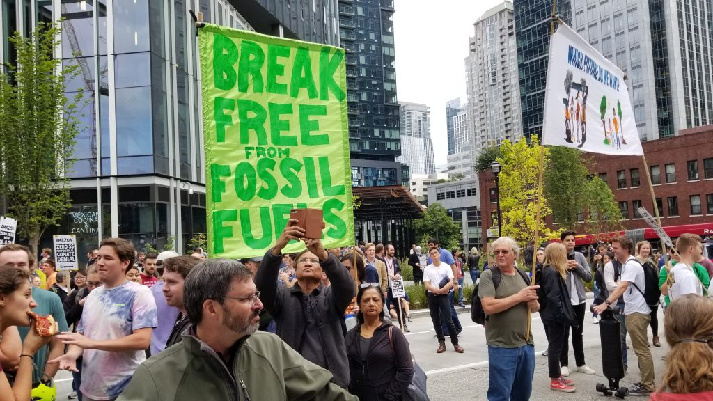 """Climate protestors with banner: """"Break Free of Fossil Fuels"""""""