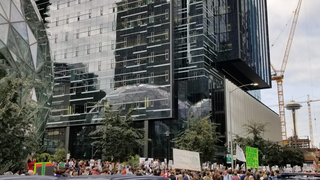 Crowd of protestors in front of Amazon building